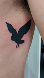 Den Tumi piercing en tattoo (43) uil owl